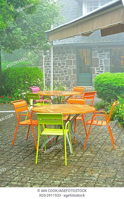 colourful tables at an outdoor restaurant, Salers, Cantal Department, Auvergne, France