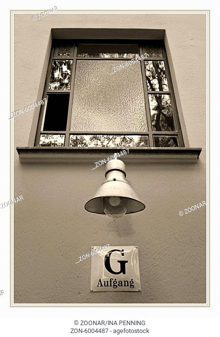 Stairwell, window to the court(yard) with lamp