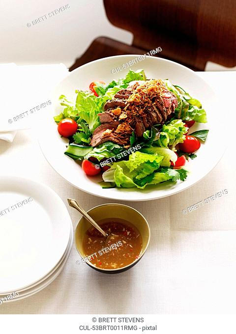 Plate of beef salad with sauce
