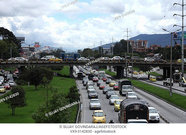 Bogota, Colombia - The traffic on the Southbound carriageway is virtually bumper to bumper. The Bridge across the Autopista leads to Calle 127 is also packed...
