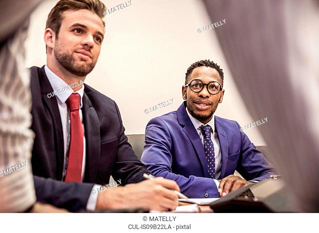 Businessmen at boardroom table meeting