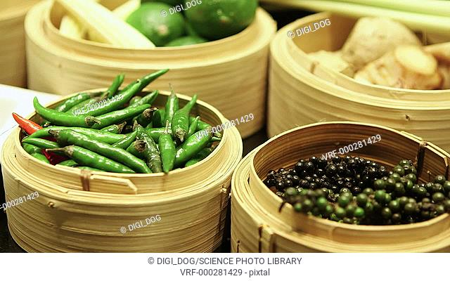 Oriental spices in bowls and bamboo steamers