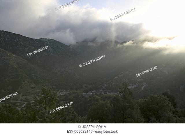 Sun breaking through storm clouds in Pine Mountain Club, Kern County, California