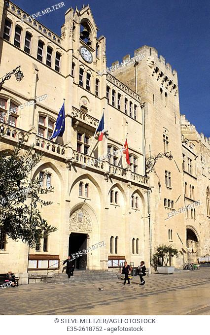The Historic heart of the city of Narbonne, France in front of the Hotel de Ville. The facade was constructed between 1846-1852 in the Troubador style