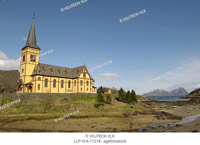 The yellow church and blue sky with clouds, Tromso in Norge