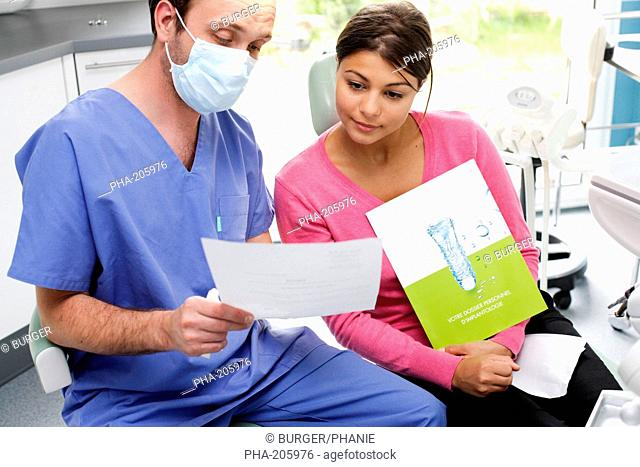 Dentist informing patient on dental implants