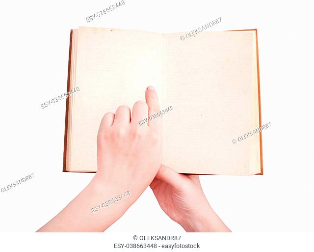 overhead view of hands holding a old book with copy space ready for text