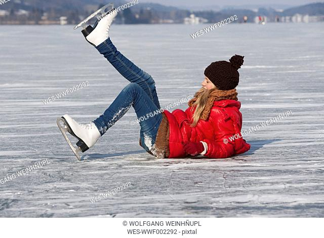 Austria, Teenage girl fallen on ice rink while skating