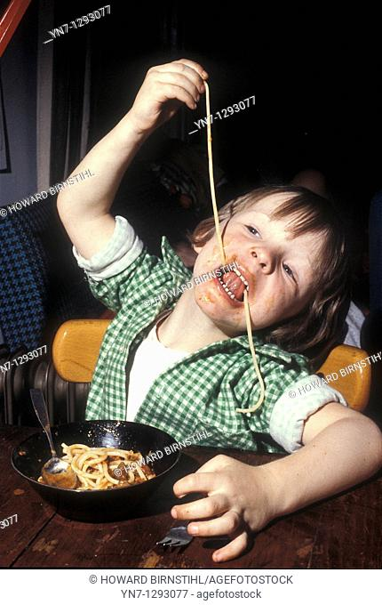 young child experimenting with spaghetti