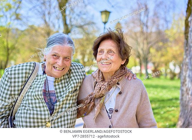 Jaunty old senior women enjoying humor and togetherness