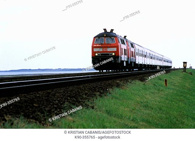 Regional train of Deutsche Bahn with diesel locomotive in double track on the Hindenburgdamm that connects Sylt island with the mainland