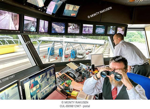 Bridge control workers in control room