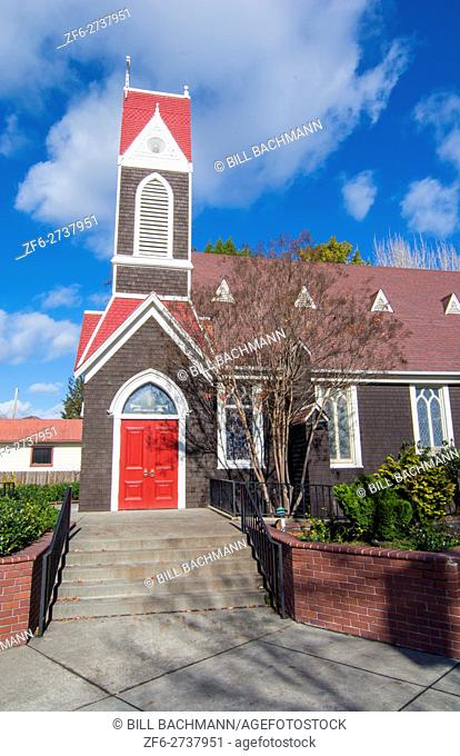 Santa Rosa California church with red door called Church of the Incarnation Episcopal Church built in 1868 with colors and clouds