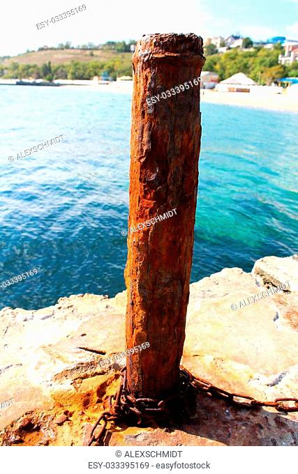 A photo of Rusty mooring capstan on a pier