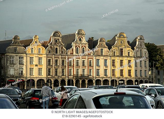 France, Arras. Cars parked in the Town Square surrounded by a unique architectural collection of Flemish-Baroque-style townhouses