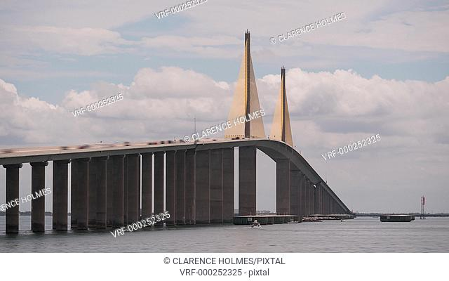 (Timelapse) Traffic crosses the Sunshine Skyway Bridge over Tampa Bay as viewed from the north fishing pier