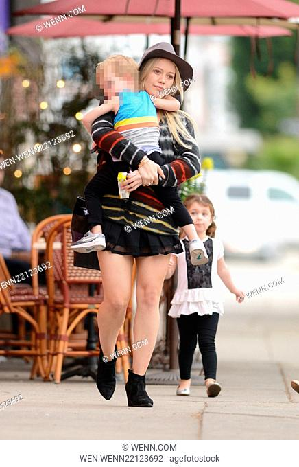 Makeup free Hilary Duff wearing a felt hat and a short black skirt, takes son Luca Comrie to Pint Size Kids Featuring: Hilary Duff