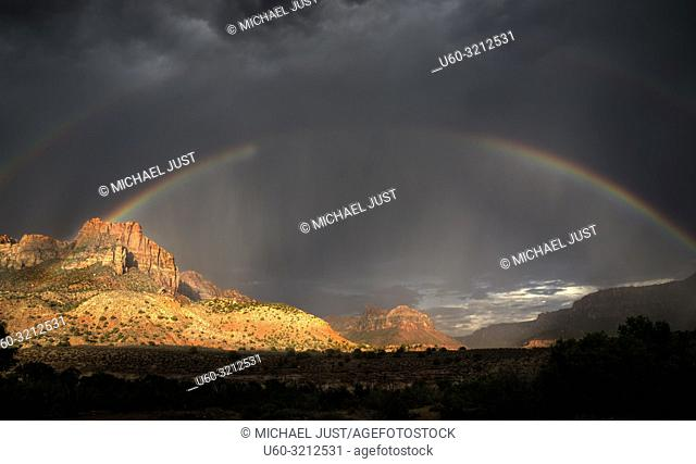 A rainbow appears during a monsoonal thunderstorm at Zion National Park, Utah