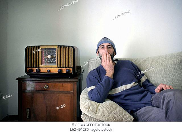 Man sitting in his sofa