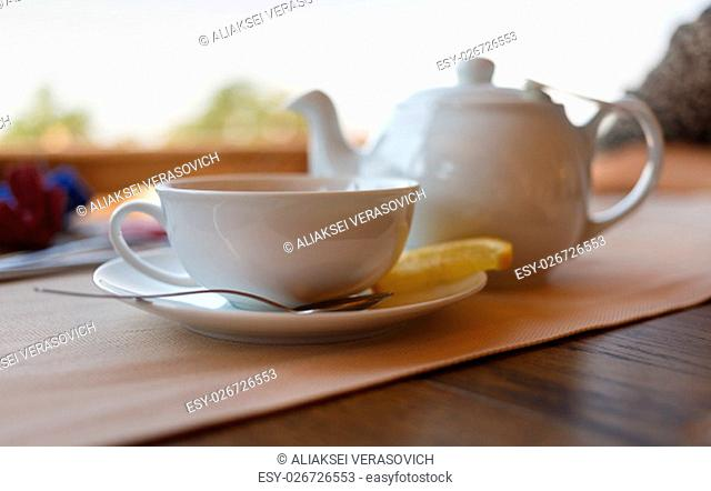 Tea with lemon and tea maker. Shallow depth of field