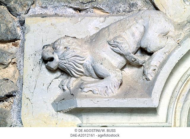 Lion with a snake, bas-relief, architectural element of Chateau de Bauge, Pays de la Loire. France, 15th century