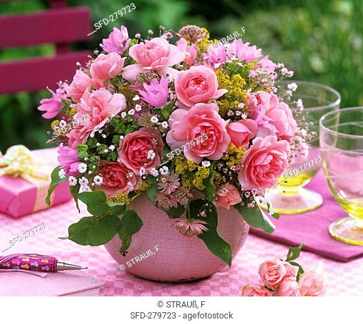 Arrangement of roses, gypsophila, lady's mantle and mallow