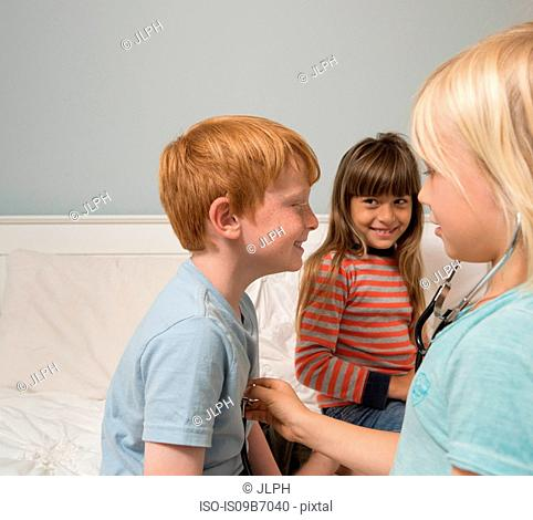 Children playing doctors with stethoscope