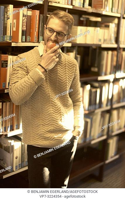 man, library, eating apple, glasses, student, books, study, university