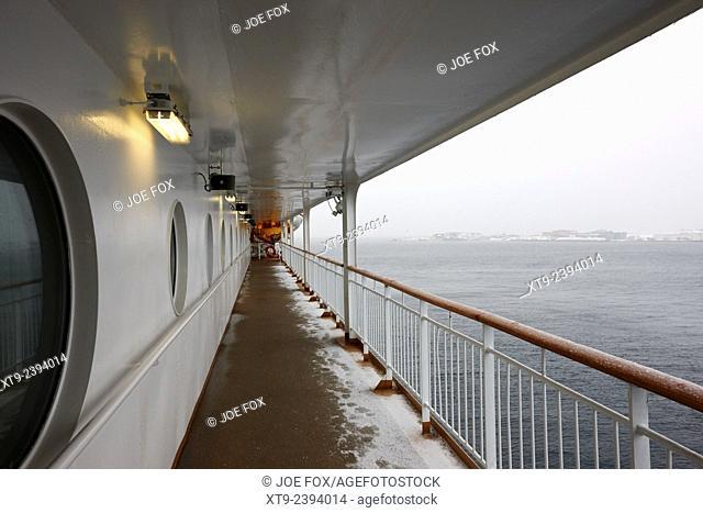 covered walkway on board hurtigruten ferry passenger ship docked in hammerfest during winter finnmark norway europe