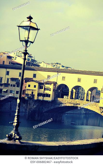"Street lamp in front of Ponte Vecchio. Photo executed in a range of """"cross processing"""""