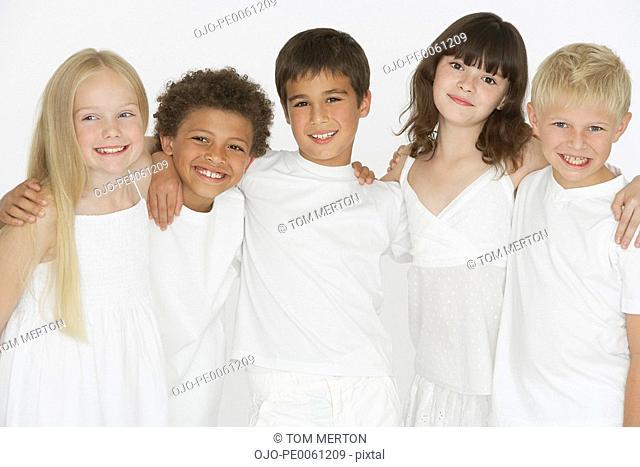 Five children indoors looking at camera