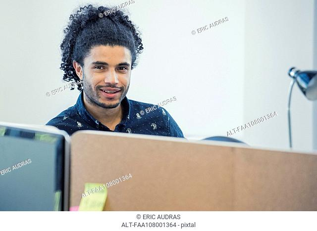 Young man in office, portrait