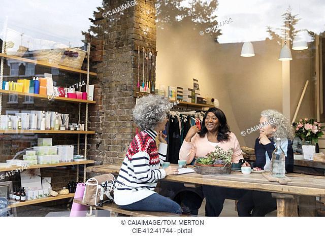 Women friends drinking tea at cafe shop