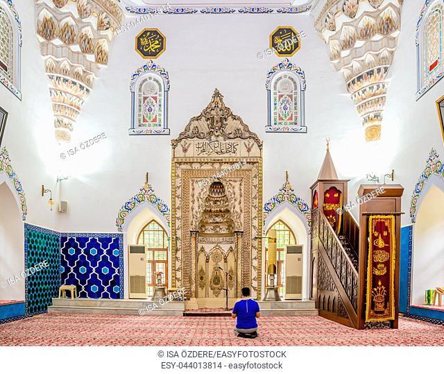 Unidentified man prays at Murat II mosque at Muradiye complex or Complex of Sultan Murat II in Bursa,Turkey. 20 May 2018