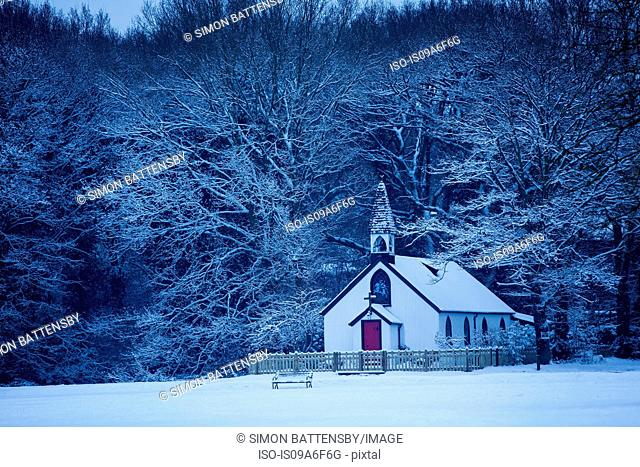 Isolated chapel in snow, St Georges Church, West End Village, nr. Esher, Surrey, UK