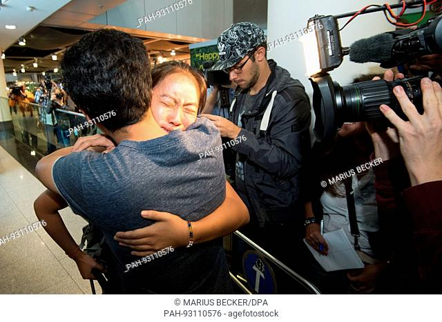 dpatop - Schoolgirl Bivsi Rana arrives to the airport and is greeted by her brother Biswash in Dusseldorf, Germany, 02 August 2017