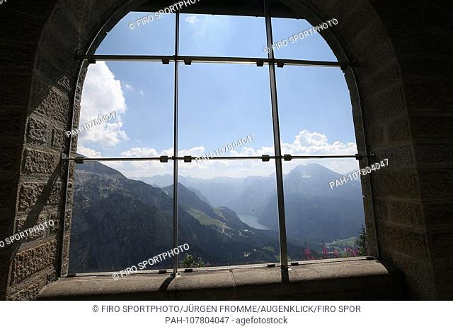 firo Land and People: Bavaria: Tourism Germany, Alps, Mountains: 31.07.2018 View from window on the Konigssee, eagles nest Kehlsteinhaus is a 1937 to 1938 built...