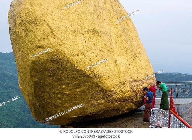 Pilgrims praying at the Golden Rock, Myanmar