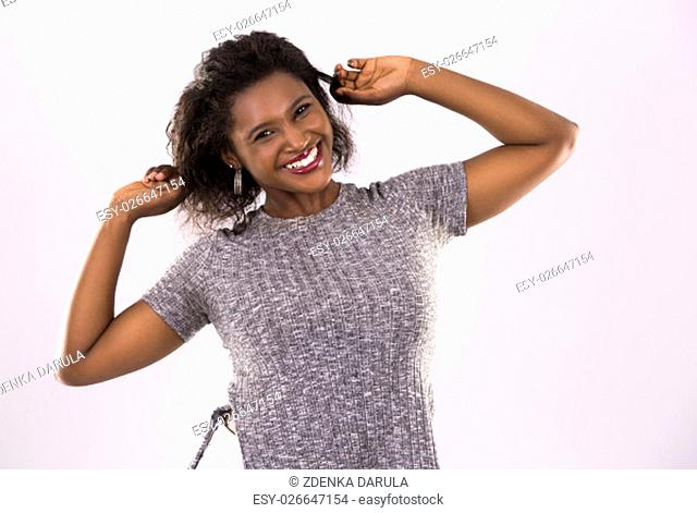 young black woman wearing casual outfit on light grey background