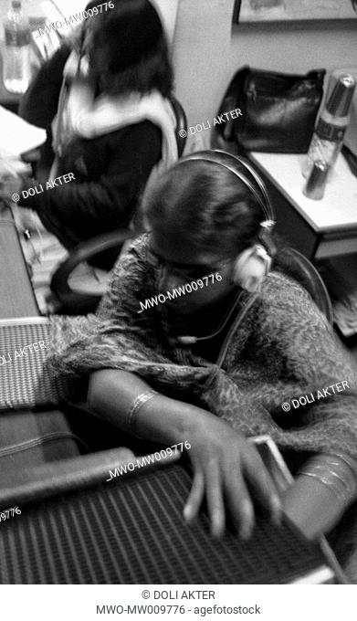 A receptionist for an NGO, Rojina searches for a telephone number her boss requested by browsing through Braille records which she wrote out herself Dhaka