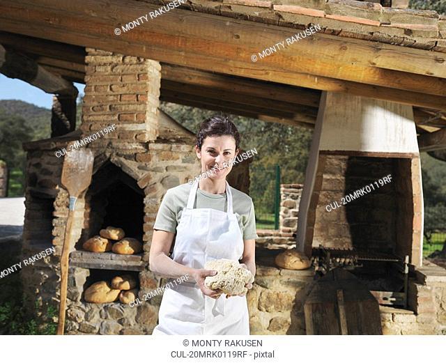 Woman holding bread dough