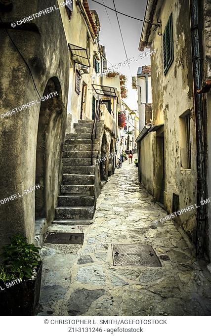 Stone steps leading up to apartments in this small Croatian village of Baska on the island of Krk in the Adriatic sea