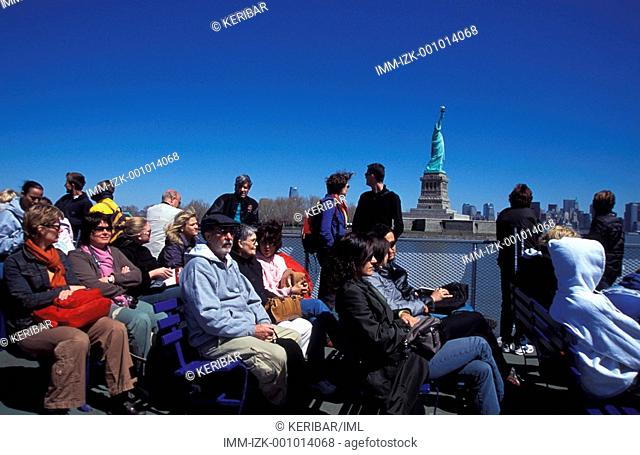 Tourists on boat going to visit the Statue of Liberty , New York City, United States, America