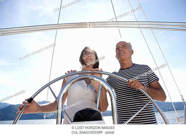 Older couple sailing together