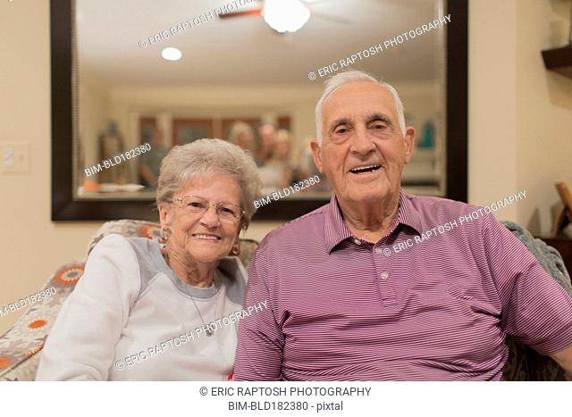 Older Caucasian couple smiling indoors