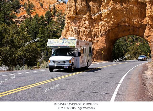A recreational vehicle traveling on the open road