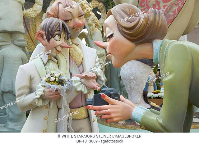 Crude carnival characters and satirical sculptures, woman filming a gay wedding, Fallas festival, Falles festival in Valencia in early spring, Spain, Europe