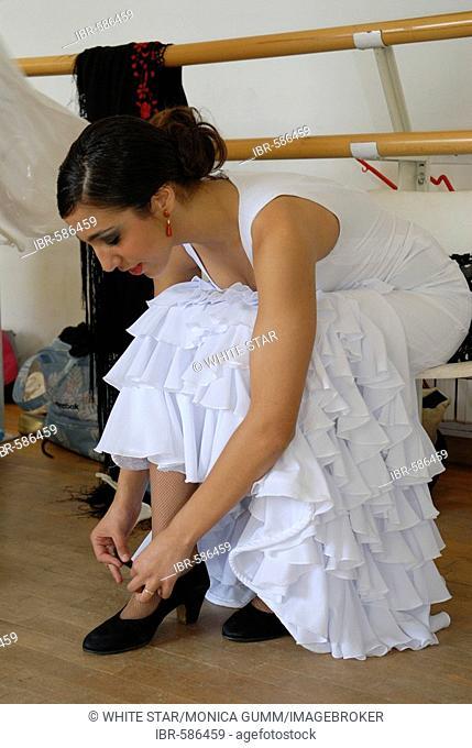 Flamenco dancer Triana putting on her shoes, Conservatorio de Danza, Sevilla, Andalusia, Spain, Europe