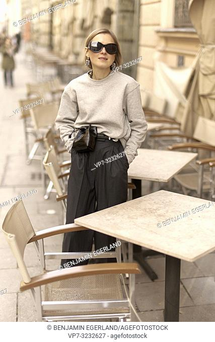 stylish blogger woman at street, streetstyle, in Munich, Bavaria, Germany