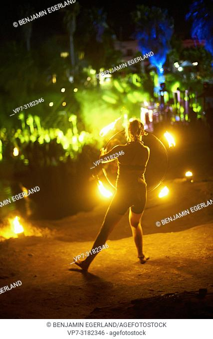 fire dancer performing at Tribal Beach Party at Starbeach Chersonissos, Crete, Greece